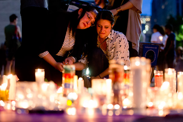 <div class='meta'><div class='origin-logo' data-origin='AP'></div><span class='caption-text' data-credit='AP Photo/Matt Rourke'>People gather for a vigil in memory of the victims of the Orlando, Fla., mass shooting, Monday, June 13, 2016, at City Hall in Philadelphia.</span></div>