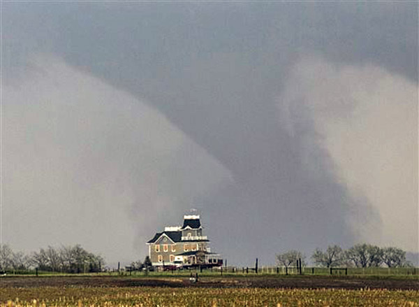 A tornado forms over a house near Pilger, Neb., Monday, June 16, 2014.  (AP Photo/Mark 'Storm' Farnik) <span class=meta></span>