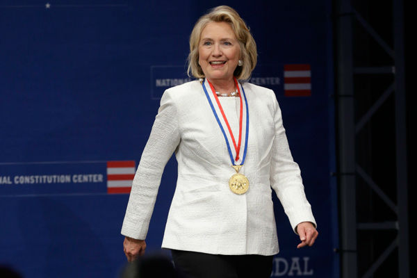 "<div class=""meta image-caption""><div class=""origin-logo origin-image none""><span>none</span></div><span class=""caption-text"">Former Secretary of State Hillary Rodham Clinton walks to the podium after receiving the Liberty Medal, Tuesday, Sept. 10, 2013, in Philadelphia. (AP Photo/ Matt Rourke)</span></div>"