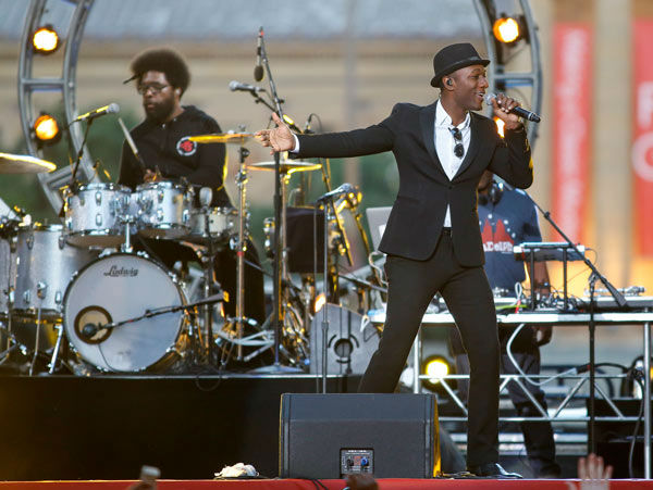 Aloe Blacc, right, performs with the Questlove, left, and The Roots at the Philly Fourth of July Jam in Philadelphia on Friday, July 4, 2014.  <span class=meta>(Photo&#47;Mark Stehle)</span>