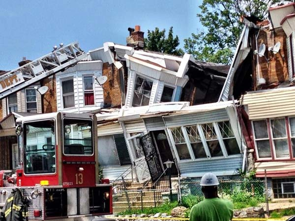 Action News reporter Walter Perez took this photo of the scene of a house collapse in the Cobbs Creek section of Philadelphia on July 7, 2014.