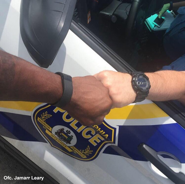 """<div class=""""meta image-caption""""><div class=""""origin-logo origin-image wpvi""""><span>WPVI</span></div><span class=""""caption-text"""">This picture was taken by Philadelphia Police Officer Jamaar Leary. Officers Leary and Officer Fitzpatrick """"felt the picture was appropriate"""" in the wake of recent events. </span></div>"""