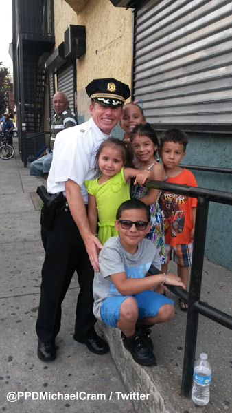 """<div class=""""meta image-caption""""><div class=""""origin-logo origin-image wpvi""""><span>WPVI</span></div><span class=""""caption-text"""">While protecting protesters, Philadelphia Police Captain Michael Cram of the 25th district spotted a few of the neighborhood kids who invited him to an upcoming block party. </span></div>"""
