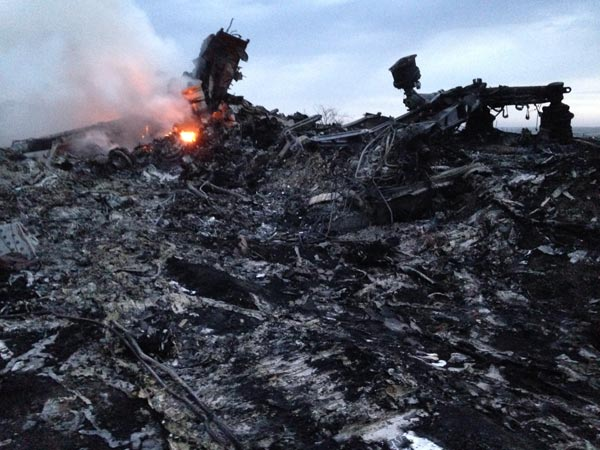 Smoke rises up at a crash site of a passenger plane, near the village of Grabovo, Ukraine, Thursday, July 17, 2014.  <span class=meta>(AP Photo&#47;Dmitry Lovetsky)</span>