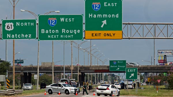 <div class='meta'><div class='origin-logo' data-origin='AP'></div><span class='caption-text' data-credit='AP Photo/Max Becherer'>Baton Rouge police block Airline Highway after police were shot in Baton Rouge, La., Sunday, July 17, 2016.</span></div>