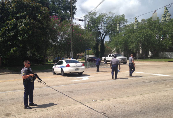 <div class='meta'><div class='origin-logo' data-origin='AP'></div><span class='caption-text' data-credit='AP Photo/Max Becherer'>Baton Rouge police officers man a roadblock at Old Hammond Highway and Tara Boulevard after multiple officers were shot, Sunday, July 17, 2016, in Baton Rouge, La.</span></div>