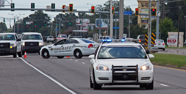 <div class='meta'><div class='origin-logo' data-origin='AP'></div><span class='caption-text' data-credit='AP Photo/Max Becherer'>Baton Rouge Police arrive at the scene on Airline Highway after police were shot in Baton Rouge, La., Sunday, July 17, 2016.</span></div>