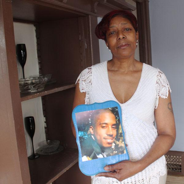 <div class='meta'><div class='origin-logo' data-origin='AP'></div><span class='caption-text' data-credit='AP Photo/Carrie Antlfinger'>Maria Hamilton holds a photo of her son Dontre Hamilton, who was fatally shot by a Milwaukee police officer in April 2014, at her home on Monday, March 30, 2015 in Milwaukee.</span></div>