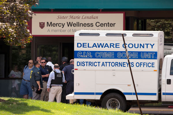 Investigators work the scene of a shooting Thursday, July 24, 2014, at Mercy Fitzgerald Hospital in Darby, Pa. <span class=meta></span>