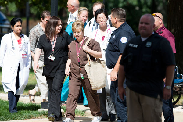 Hospital workers leave the scene of a shooting Thursday, July 24, 2014, at Mercy Fitzgerald Hospital in Darby, Pa. <span class=meta>AP Photo</span>