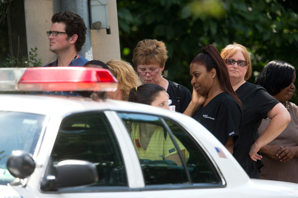 Hospital workers view police activity at the scene of a shooting Thursday, July 24, 2014, at Mercy Fitzgerald Hospital in Darby, Pa. <span class=meta>AP Photo</span>