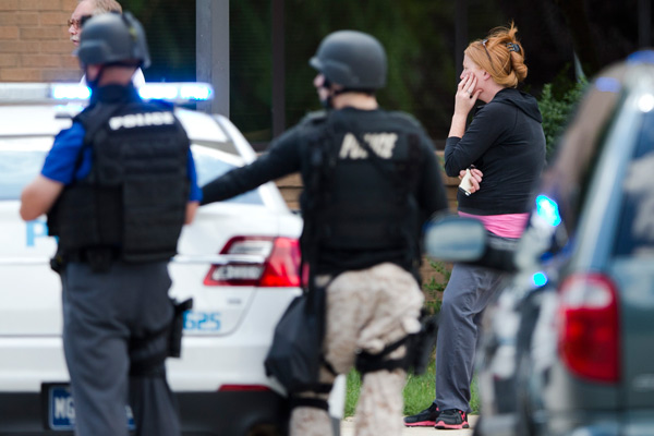 "<div class=""meta ""><span class=""caption-text "">A hospital worker views police activity around the scene of a shooting Thursday, July 24, 2014, at Mercy Fitzgerald Hospital in Darby, Pa.  (AP Photo)</span></div>"