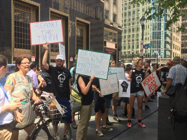 <div class='meta'><div class='origin-logo' data-origin='WPVI'></div><span class='caption-text' data-credit=''>Demonstrators protest at the Comcast Center in Philadelphia as the city prepared for Day 3 of the Democratic National Convention.</span></div>