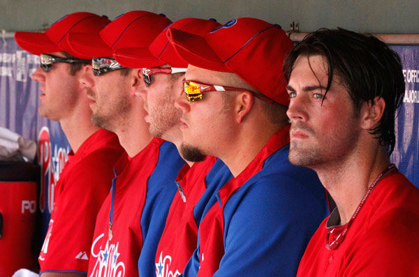<div class='meta'><div class='origin-logo' data-origin='none'></div><span class='caption-text' data-credit='Photo/Gene J. Puskar'>Roy Halladay sits in the dugout with fellow Phillies starting pitchers Cole Hamels, Roy Oswalt, Cliff Lee and Joe Blanton during spring training, March 24, 2011.</span></div>