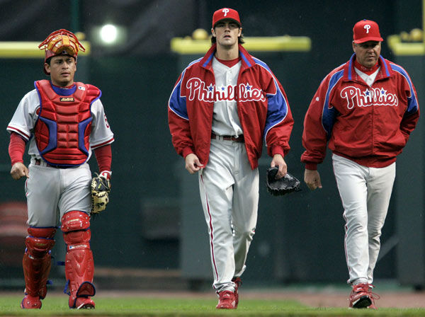<div class='meta'><div class='origin-logo' data-origin='none'></div><span class='caption-text' data-credit='Photo/AL BEHRMAN'>Cole Hamels, center, walks to the dugout with catcher Carlos Ruiz, left, and pitching coach Rich Dubee before his major league debut on May 12, 2006.</span></div>