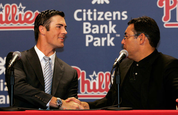 <div class='meta'><div class='origin-logo' data-origin='none'></div><span class='caption-text' data-credit='Photo/Tom Mihalek'>Cole Hamels, left, and general manager Ruben Amaro, Jr., shake hands during a news conference in Philadelphia, Wednesday, July 25, 2012.</span></div>
