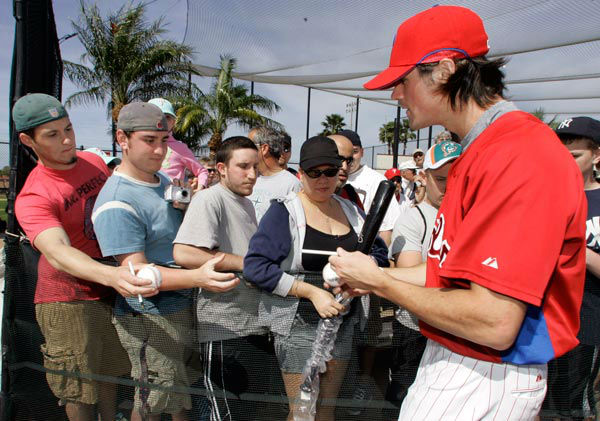 <div class='meta'><div class='origin-logo' data-origin='none'></div><span class='caption-text' data-credit='Photo/Chuck Burton'>Philadelphia Phillies' Cole Hamels, right, signs autographs for fans during spring training baseball in Clearwater, Fla., Saturday, Feb. 24, 2007.</span></div>