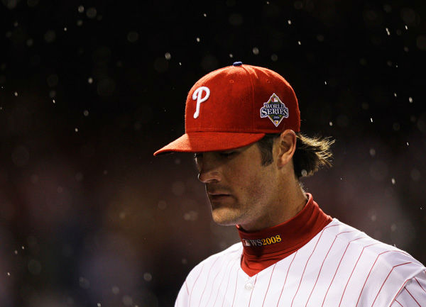 <div class='meta'><div class='origin-logo' data-origin='none'></div><span class='caption-text' data-credit='Photo/David J. Phillip'>Cole Hamels walks back to the dugout as the rain falls during  Game 5 of the World Series against the Tampa Bay Rays in Philadelphia, Oct. 27, 2008.</span></div>