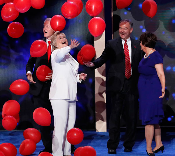 "<div class=""meta image-caption""><div class=""origin-logo origin-image ap""><span>AP</span></div><span class=""caption-text"">Democratic presidential nominee Hillary Clinton taps balloons as they fall around her, Former President Bill Clinton, Sen. Tim Kaine, D-Va, and Kanie's wife Anne Holton. (AP Photo/J. Scott Applewhite)</span></div>"