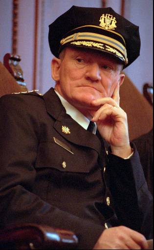 """<div class=""""meta image-caption""""><div class=""""origin-logo origin-image none""""><span>none</span></div><span class=""""caption-text"""">Philadelphia's new Police Commissioner John F. Timoney listens to speakers at his swearing-in ceremony, Tuesday, March 10, 1998, in Philadelphia. (ASSOCIATED PRESS)</span></div>"""