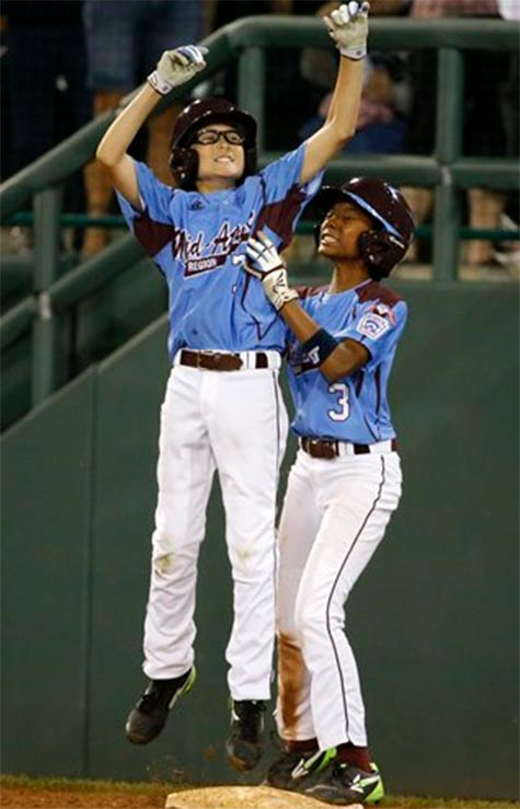 Philadelphia's Tai Shanahan (7) celebrates his walk-off single with teammate Mo'ne Davis (3) in the Little League World Series, Sunday, Aug. 17, 2014. <span class=meta>(AP Photo/Gene J. Puskar)</span>