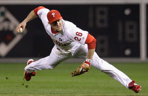 <div class='meta'><div class='origin-logo' data-origin='none'></div><span class='caption-text' data-credit='AP Photo/ Matt Slocum'>Chase Utley throws to first on a hit during the first inning of Game 4 of the World Series Sunday, Nov. 1, 2009, in Philadelphia.</span></div>