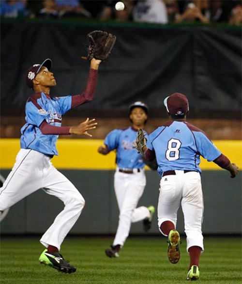 Philadelphia center fielder Kai Cummings, left and second baseman Jahli Hendricks (8) can't get to at the Little League World Series, Wednesday, Aug. 20, 2014. <span class=meta>(AP Photo/Gene J. Puskar)</span>