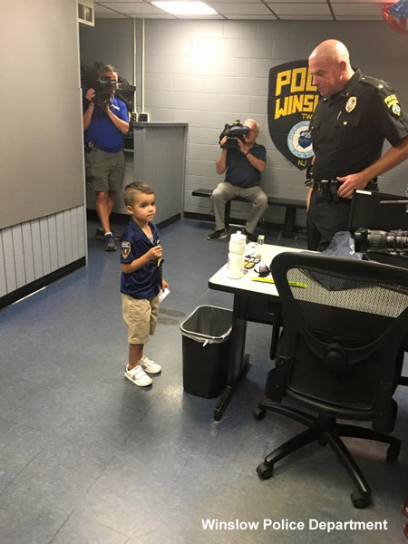 <div class='meta'><div class='origin-logo' data-origin='none'></div><span class='caption-text' data-credit=''>5-year-old William Evertz Jr. delivered lunch to police officers at Winslow Township.</span></div>