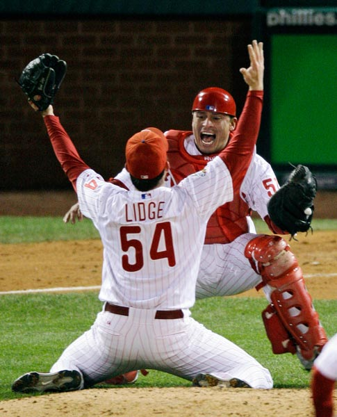 """<div class=""""meta image-caption""""><div class=""""origin-logo origin-image ap""""><span>AP</span></div><span class=""""caption-text"""">Philadelphia Phillies catcher Carlos Ruiz celebrates with relief pitcher Brad Lidge (54) after the final out in Game 5 of the baseball World Series in Philadelphia. (Charles Krupa)</span></div>"""