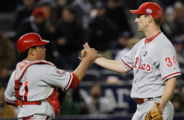 """<div class=""""meta image-caption""""><div class=""""origin-logo origin-image ap""""><span>AP</span></div><span class=""""caption-text"""">Philadelphia Phillies' Cliff Lee is congratulated by catcher Carlos Ruiz after defeating the New York Yankees in Game 1 of the 2009 Major League Baseball World Series. (David J. Phillip)</span></div>"""