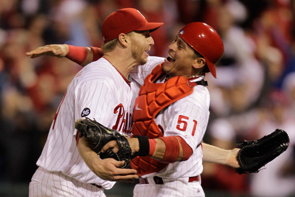 """<div class=""""meta image-caption""""><div class=""""origin-logo origin-image ap""""><span>AP</span></div><span class=""""caption-text"""">Philadelphia Phillies starting pitcher Roy Halladay, left, celebrates with catcher Carlos Ruiz (51) after throwing a no-hitter during Game 1 NLDS 2010. (AP Photo/Rob Carr)</span></div>"""