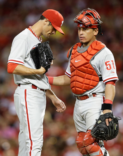 """<div class=""""meta image-caption""""><div class=""""origin-logo origin-image ap""""><span>AP</span></div><span class=""""caption-text"""">Philadelphia Phillies catcher Carlos Ruiz (51) talks with starting pitcher Cole Hamels in the eighth inning of a baseball game against the Cincinnati Reds, Friday, June 6, 2014. (AP Photo/Al Behrman)</span></div>"""