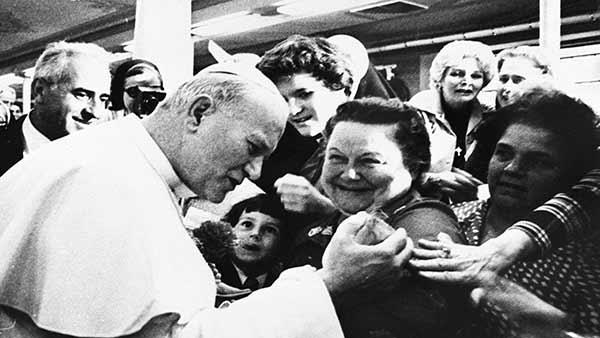 <div class='meta'><div class='origin-logo' data-origin='AP'></div><span class='caption-text' data-credit=''>In this 1979 file photo Pope John Paul II greets crowd at the Convention Center.</span></div>