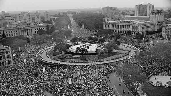 <div class='meta'><div class='origin-logo' data-origin='AP'></div><span class='caption-text' data-credit=''>In this Oct. 3, 1979 file photo Pope John Paul II performs an outdoor mass for a huge audience at Logan Circle in Philadelphia.</span></div>