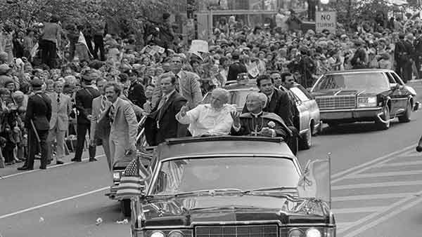 <div class='meta'><div class='origin-logo' data-origin='AP'></div><span class='caption-text' data-credit='Jack Kanthal'>Pope John Paul II, in white, and Cardinal John Krol wave to the crowd welcoming the Pontiff to Philadelphia, Pa., Oct. 3, 1979.</span></div>