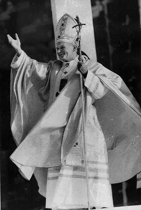 <div class='meta'><div class='origin-logo' data-origin='AP'></div><span class='caption-text' data-credit='Rusty Kennedy'>With his robes flowing in the breeze, Pope John Paul II gestures to a huge crowd attending an outdoor mass at Logan Circle in Philadelphia, Pa., Oct. 3, 1979.</span></div>