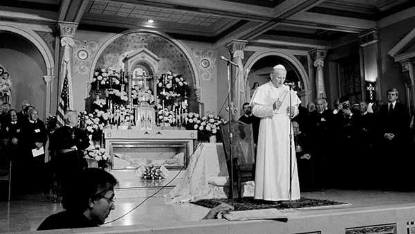 <div class='meta'><div class='origin-logo' data-origin='AP'></div><span class='caption-text' data-credit='Rusty Kennedy'>Pope John Paul II speaks to a small crowd at the St. Peter the Apostle Church in Philadelphia, Pa., Oct. 4, 1979.</span></div>