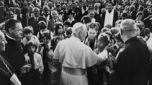 <div class='meta'><div class='origin-logo' data-origin='AP'></div><span class='caption-text' data-credit=''>Pope John Paul II touches one of the children gathered in front of the Ukrainian Church in Philadelphia, Pa., Oct. 4, 1979.</span></div>