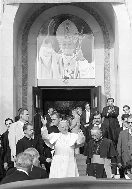 <div class='meta'><div class='origin-logo' data-origin='AP'></div><span class='caption-text' data-credit='Paul Vathis'>Pope John Paul II waves to the crowd in front of the Ukrainian Church in Philadelphia, Pa., Oct. 4, 1979. At right is Cardinal John Krol of Philadelphia.</span></div>