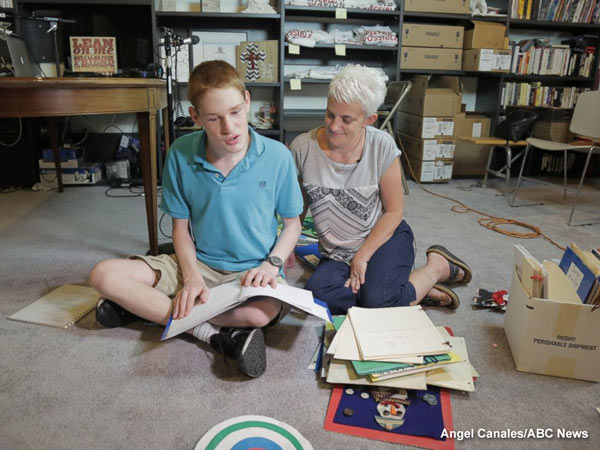 """<div class=""""meta image-caption""""><div class=""""origin-logo origin-image none""""><span>none</span></div><span class=""""caption-text"""">Christopher Duffley with his former Para Teacher Lisa Hanel in his home in Manchester, NH. July 26, 2016.</span></div>"""