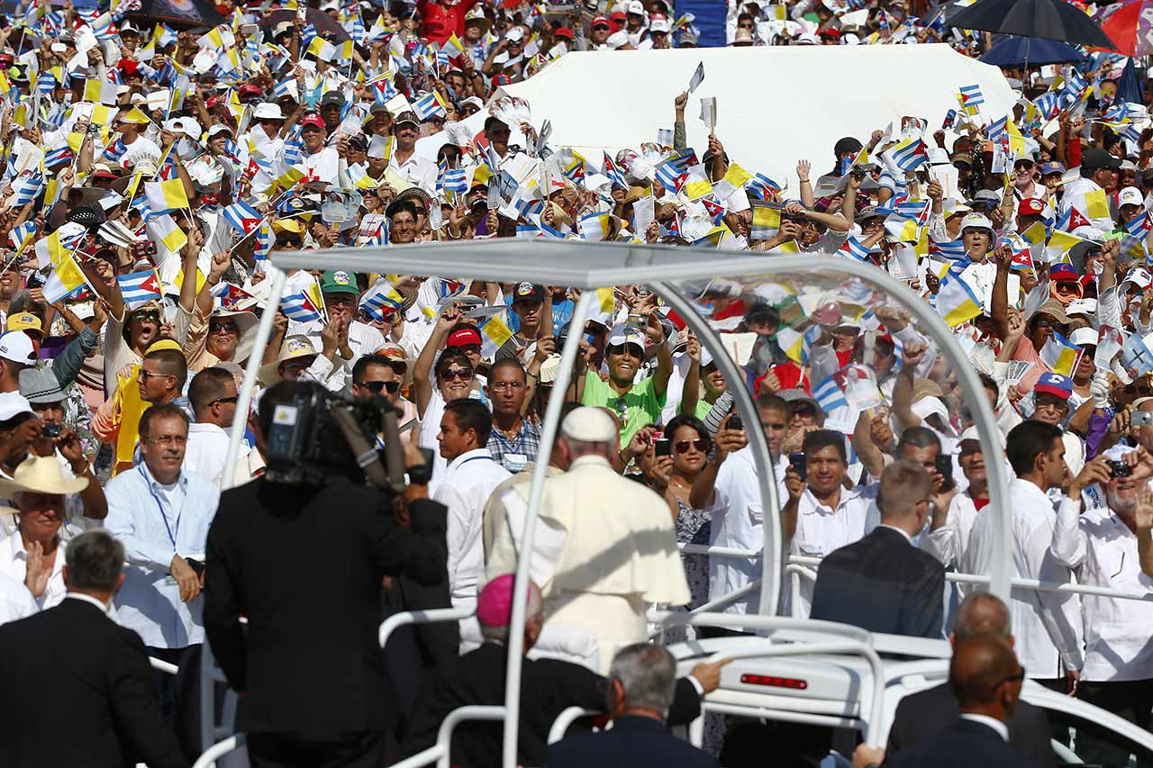 "<div class=""meta image-caption""><div class=""origin-logo origin-image none""><span>none</span></div><span class=""caption-text"">Pope Francis waves from his popemobile as he travels to the Plaza of the Revolution to celebrate Mass in Holguin, Cuba, Monday, Sept. 21, 2015.  (Enrique De La Osa/Pool via AP)</span></div>"