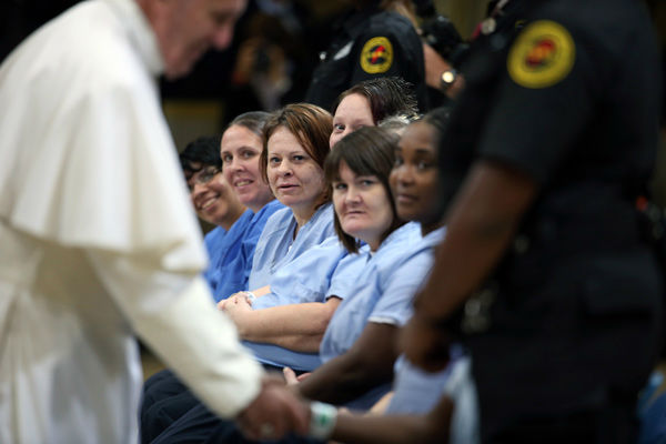 <div class='meta'><div class='origin-logo' data-origin='none'></div><span class='caption-text' data-credit='Photo/David Maialetti'>Pope Francis greets female inmates during his visit to the Curran Fromhold Correctional Facility in Philadelphia, Sunday, Sept. 27, 2015.</span></div>