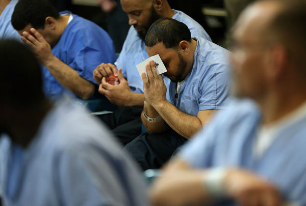 <div class='meta'><div class='origin-logo' data-origin='none'></div><span class='caption-text' data-credit='Photo/David Maialetti'>Inmate David Hernandez, 39, of North Philadelphia, prays during Pope Francis' visit to Curran Fromhold Correctional Facility in Philadelphia, Sunday, Sept. 27, 2015.</span></div>