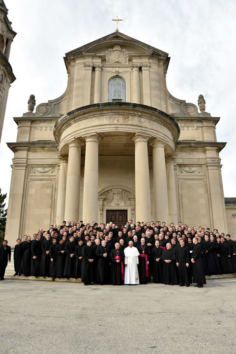 <div class='meta'><div class='origin-logo' data-origin='none'></div><span class='caption-text' data-credit='Photo/Tom Gralish'>Pope Francis, in white, poses with seminarians on the steps of St. Martin of Tours Chapel at St. Charles Borromeo Seminary, following his address to the Bishops.</span></div>