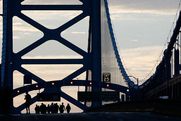 <div class='meta'><div class='origin-logo' data-origin='none'></div><span class='caption-text' data-credit='Photo/Julio Cortez'>A family from Trenton, N.J., originally from Ecuador, walk over the Benjamin Franklin Bridge ahead of a Sunday Mass.</span></div>