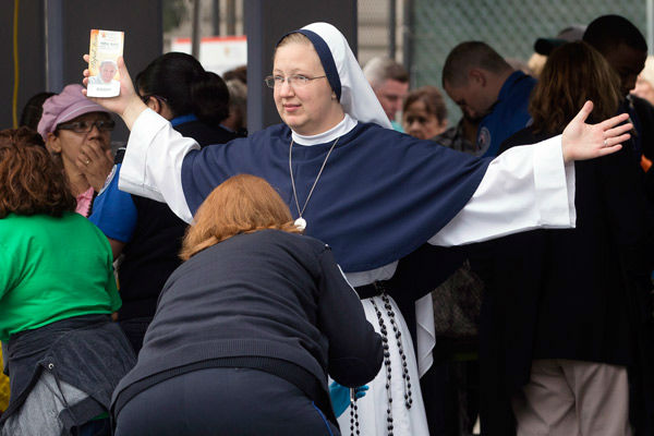 <div class='meta'><div class='origin-logo' data-origin='~ORIGIN~'></div><span class='caption-text' data-credit='Photo/John Minchillo'>A nun from The Sisters of Life, of New York City, is inspected at a security checkpoint as she arrives for a Mass.</span></div>