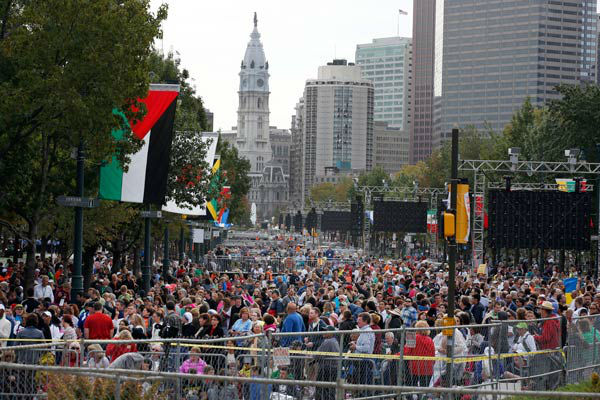 <div class='meta'><div class='origin-logo' data-origin='~ORIGIN~'></div><span class='caption-text' data-credit='Photo/Alex Brandon'>A crowd of people gathers on Benjamin Franklin Parkway before a Mass celebtated by Pope Francis, Sunday, Sept. 27, 2015 in Philadelphia.</span></div>