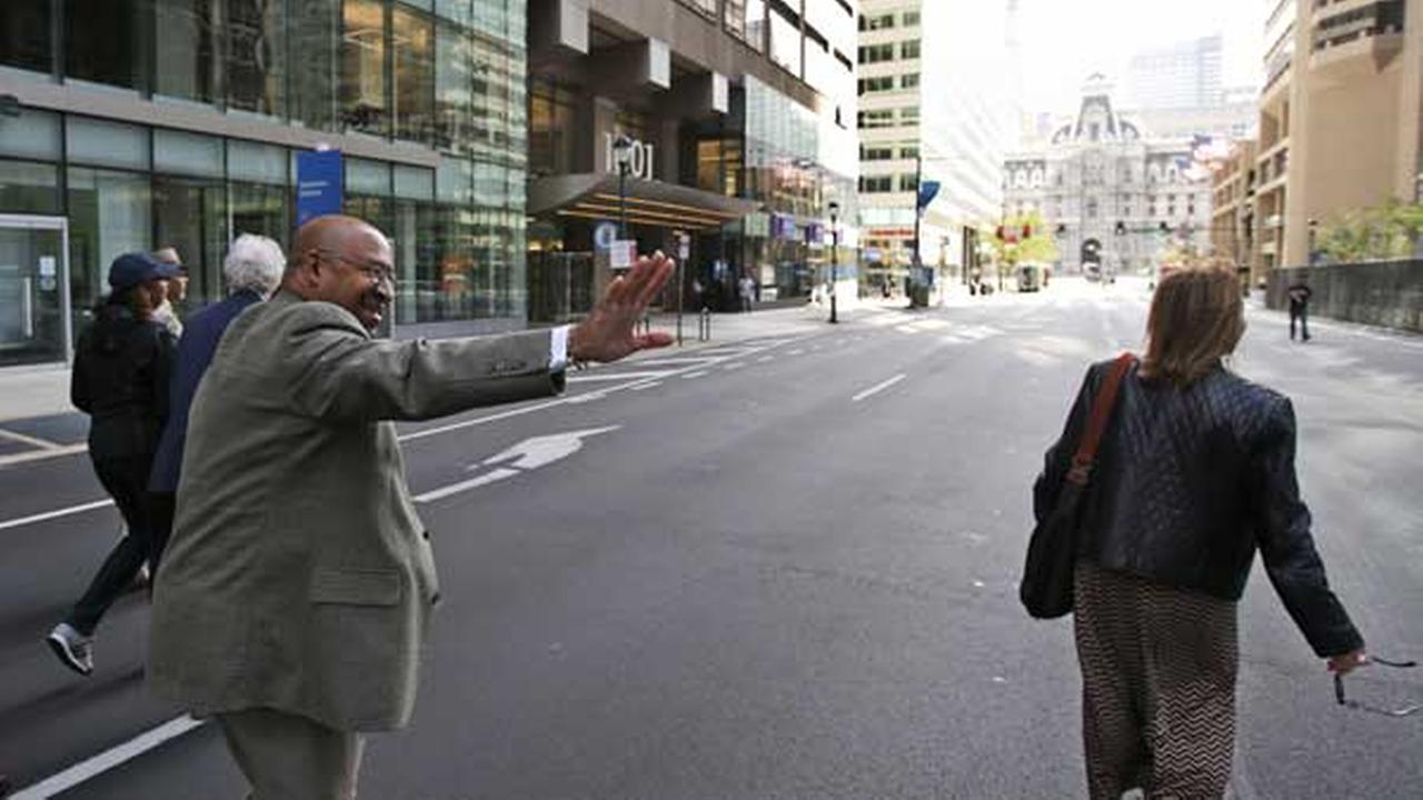 Philadelphia Mayor Michael Nutter waves as he walks down Market Street on his way to City Hall in Philadelphia on Friday, Sept. 25, 2015, before Pope Francis upcoming visit. AP Photo/Alex Brandon