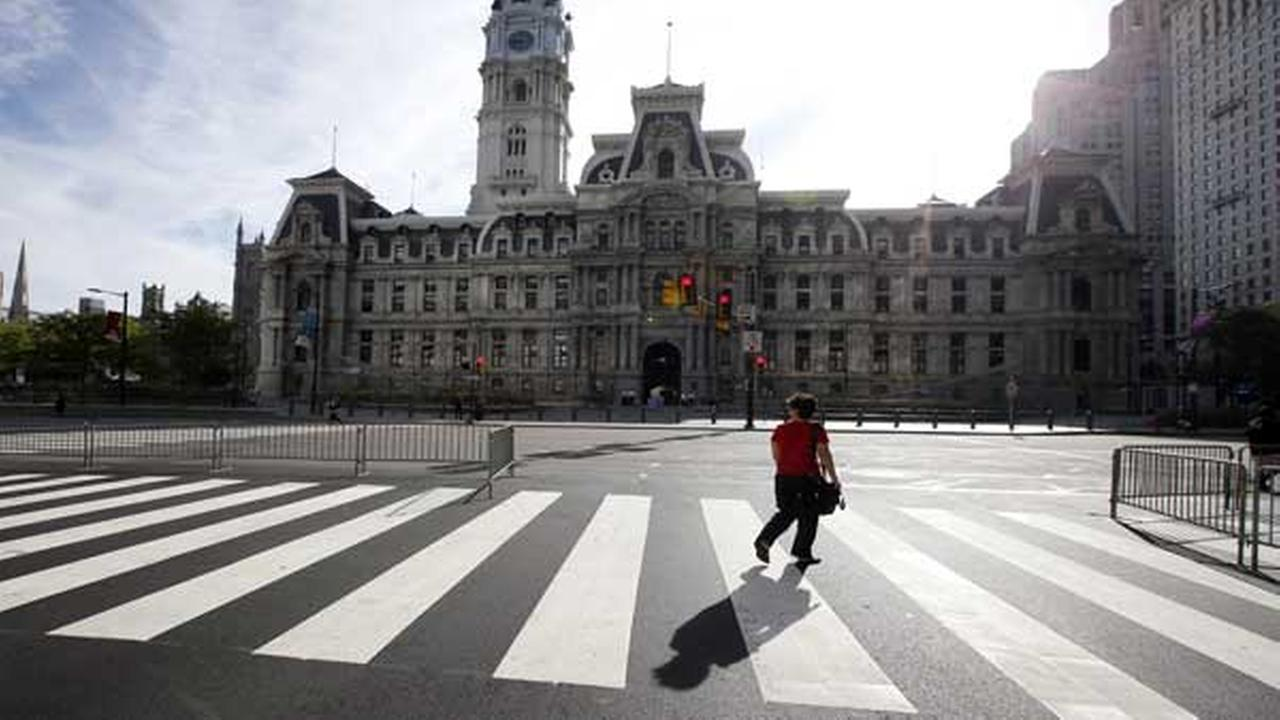 A woman walks around a quiet City Hall in Philadelphia on Friday, Sept. 25, 2015, before Pope Francis upcoming visit.AP Photo/Alex Brandon