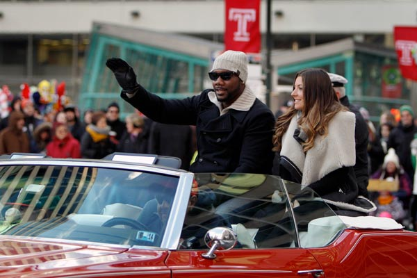<div class='meta'><div class='origin-logo' data-origin='AP'></div><span class='caption-text' data-credit='AP Photo/ Joseph Kaczmarek'>Philadelphia Phillies first baseman Ryan Howard, left, and his wife Krystal Howard ride in a convertible during the 94th annual Thanksgiving Day Parade, Thursday, Nov. 28, 2013.</span></div>